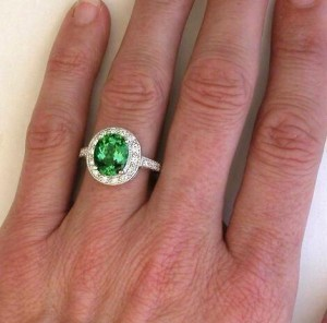 Green garnet with white diamonds, set in white gold.